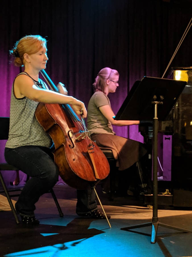 Dr. Katherine Decker (left) and student Bridget Mullin (right) perform.