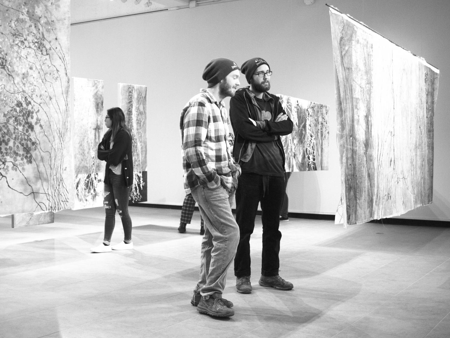 Students view Hunder's exhibition at the gallery's reception last Thursday night.