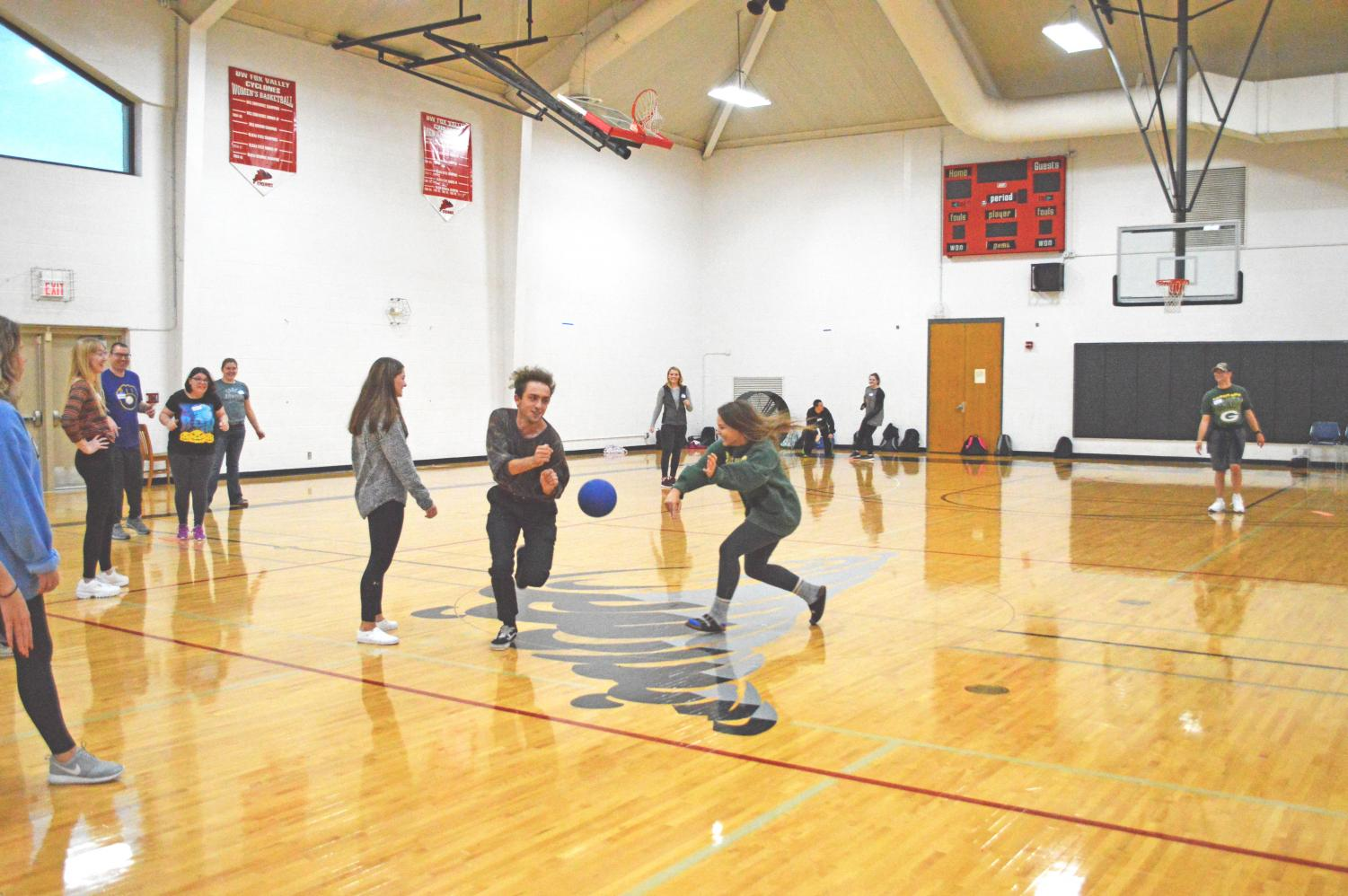 UWO-FC students enrolled in a service learning course play kickball with students from Thrive Career Academy