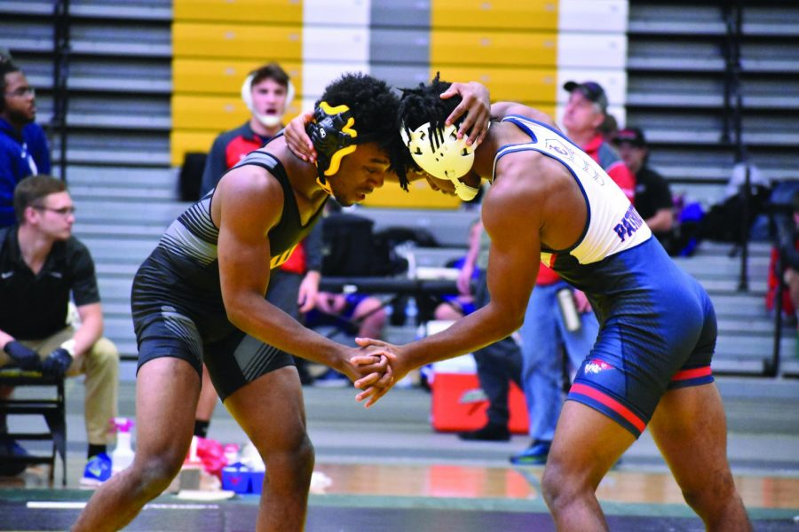 Sophomore+Kobe+Allen+grapples+with+a+opposing+wrestler+during+the+Dan+Gable+Open+on+Nov.+9.+UWO+lost+to+UW-Eau+Claire+on+Saturday+25-9%2C+making+them+0-2+in+WIAC+competition.+