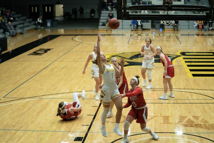 Senior Olivia Campbell drives to the hoop against her opponent in Oshkosh's 68-54 win over Saint Mary's University (Minn.).