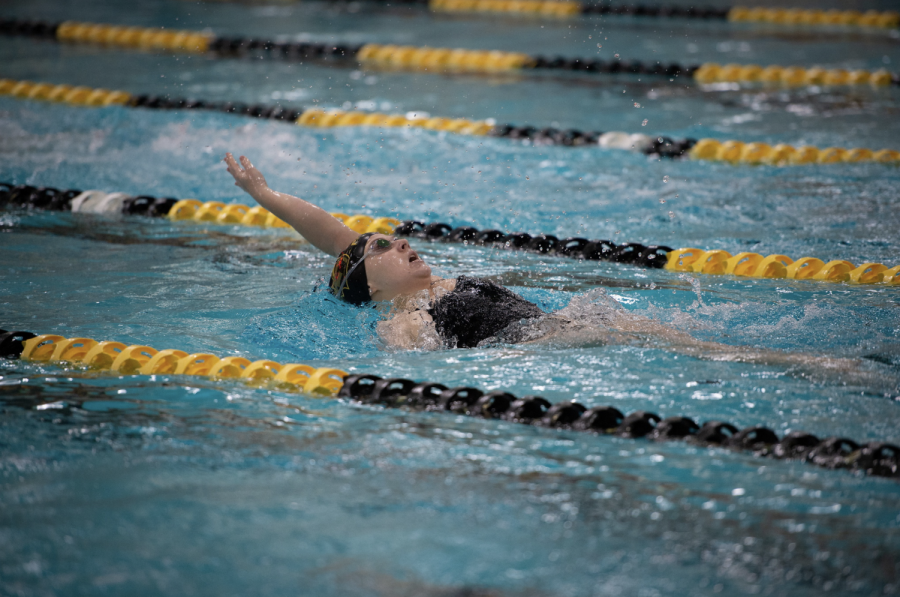 A+UW+Oshkosh+swimmer+performs+the+backstroke+at+the+home+meet+against+UW-Eau+Claire+on+Oct.+12.+