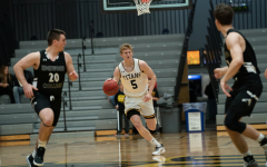 Men's basketball loses first game since last season