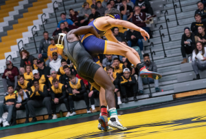 Wrestling dominates in season opener