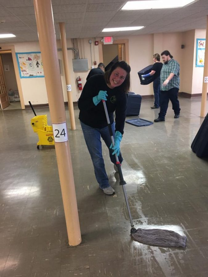Volunteers clean the Day by Day Warming Shelter in Oshkosh. Photo courtesy Day by Day Facebook