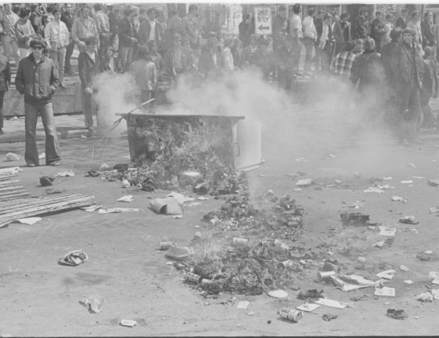 UW Oshkosh Archives Photo — In 1970, students on what is now UW Oshkosh lit tires and trash cans on fire to protest the war and Algoma Boulevard safety concerns.