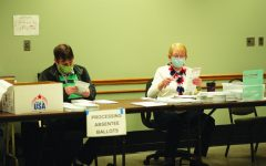 April Lee / Advance-Titan — Poll workers in Oshkosh kept busy in April with absentee ballots.