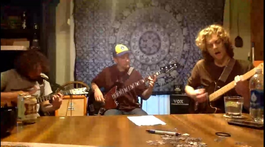 """From left to right, Daniel Saxes, David Stevens and Mike Stevens perform songs from their album """"Ted's Basement"""" in Saxes' kitchen."""
