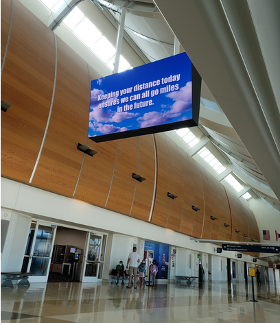 Kaitlyn Scoville / The Advance-Titan — Signs in airports remind travelers to social distance.