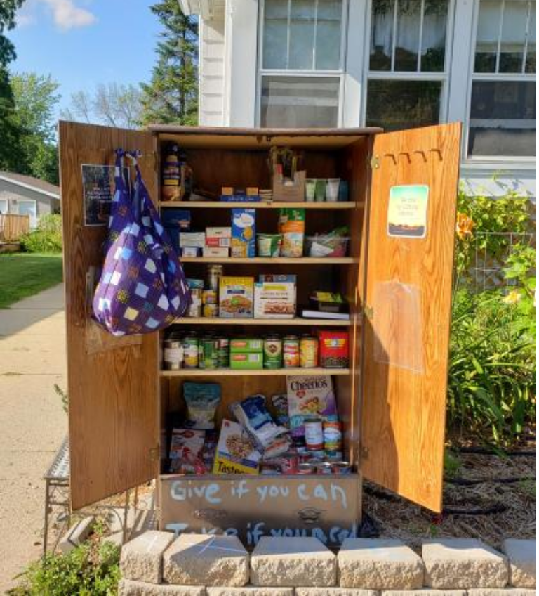 Kaitlyn Scoville / The Advance-Titan — Mary Drephal, with two young children and a working husband, has stepped up to address food insecurity in her neighborhood on West 16th Avenue by putting up a curbside pantry.