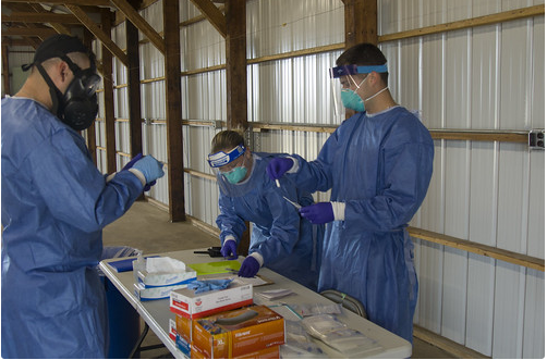 Citizen soldiers and airmen from the Wisconsin National Guard collect specimens for COVID-19 testing June 11 at the Merrill Festival Grounds in Merrill. The National Guard is opening up a testing site in Oshkosh on Sept. 1.  Photo by Sgt. Alice Ripberger