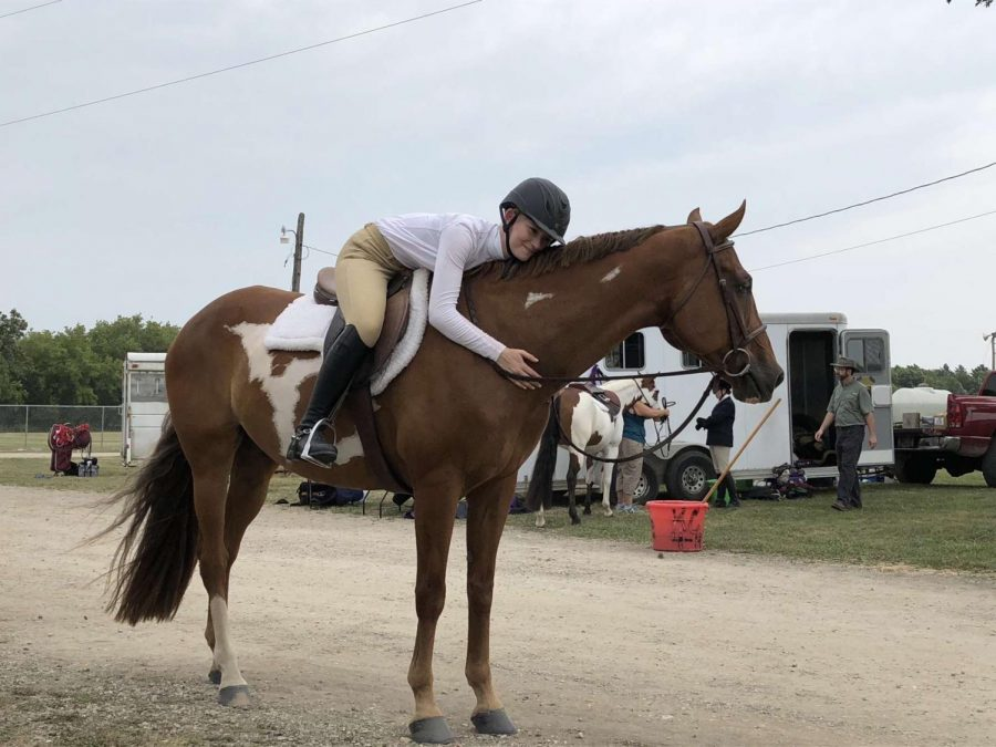 Emma Shodis embraces her horse at a competition at Kenosha County Fairgrounds.