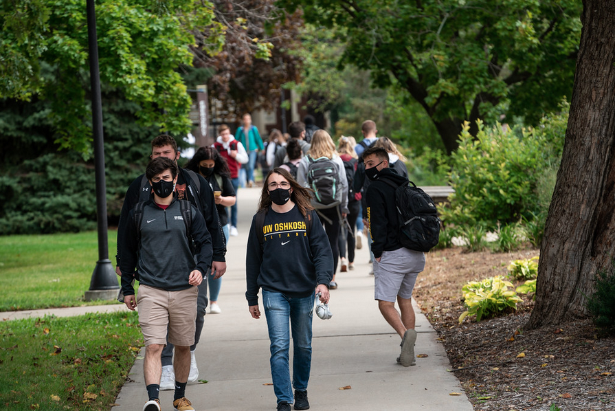 UWO Flickr — Students wearing masks to and from classes is now a common sight on the UW Oshkosh campus.