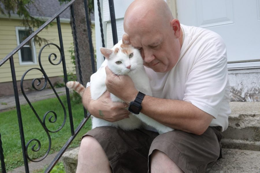 Chris and his cat, Rommel, whom he adopted after Mr. Pooh died. Chris credits Mr. Pooh for saving his life after the cat came up to him and rubbed against his leg, giving him a moment of clarity just before he was about to kill himself.