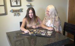 Jenna Washuleski and her niece, Makayla Brewington, look through a photo album together. Jenna took legal kinship of Makayla when she was 13.