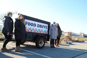 Volunteers collect food donations for Father Carr