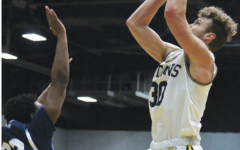 Katie Pulvermacher / Advance-Titan Sophomore forward Levi Borchert (pictured) put up a career high 21 points behind junior guard Hunter Plamann's season high 27 points in UWO's 98-89 victory over UWS.