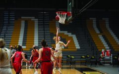 April Lee / Advance-Titan Leah Porath's 30 point performance against UWRF on March 1 broke the UWO school record of 29 points .