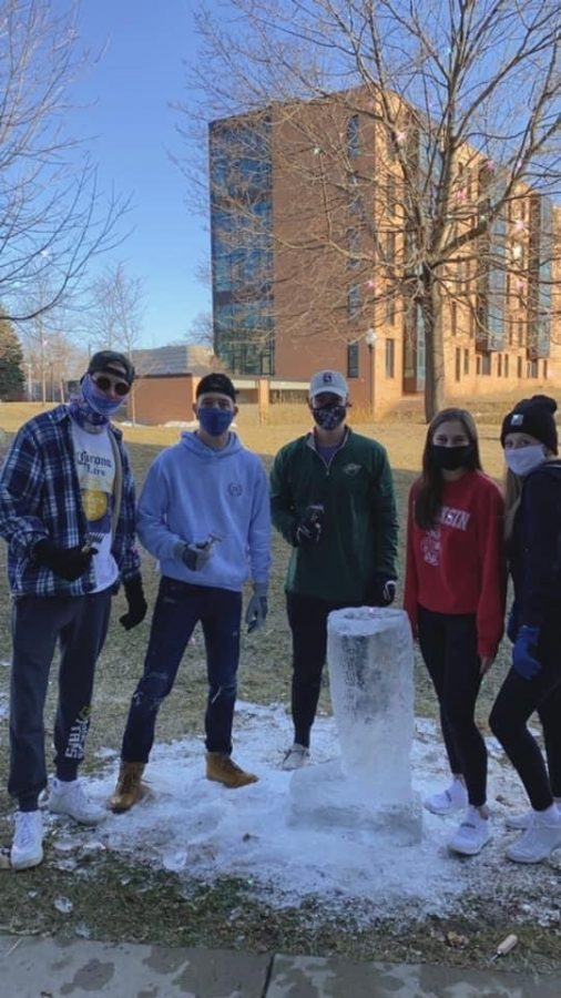 Courtesy of Hannah Osborn // Alpha Xi Delta and Sigma Pi ice-sculpting a boot to represent their theme of Country USA.