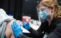 UWO Flickr — UWO nursing student Alexis Dietsche of Loyal, Wisconsin, prepares and administers a COVID-19 vaccine at a vaccine center at the Fox Cities Exhibition Center in Appleton on May 12.