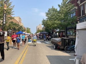 Kylie Balk-Yaatenen / Advance-Titan  Community members, UWO students and local vendors line the streets of downtown Oshkosh for the local farmer's market held each Saturday in the summer.