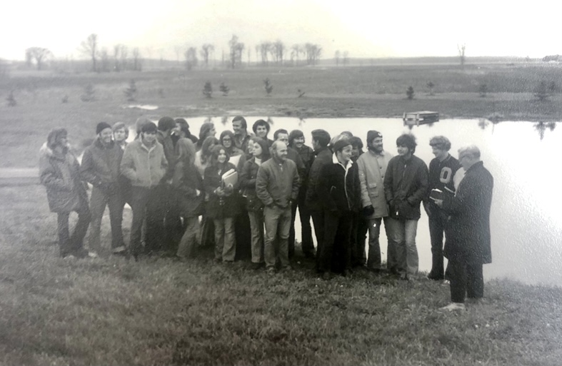 """Courtesy of the Netzer family UW Oshkosh Geography Professor Donald Netzer often took his students to a pond on his hobby farm to teach conservation techniques. Some of his students referred to the farm as """"Doc's little piece of paradise."""" This photo was taken in 1966."""